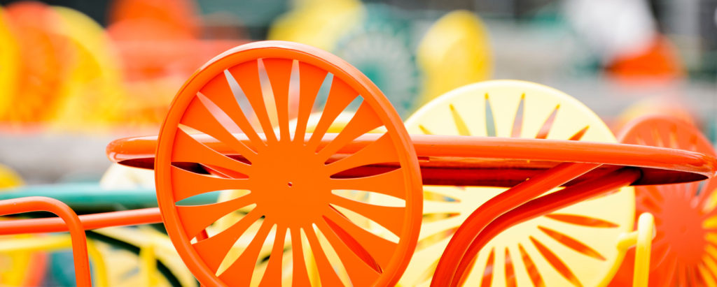 Chairs featuring an iconic sunburst pattern populate the Memorial Union Terrace at the University of Wisconsin-Madison.