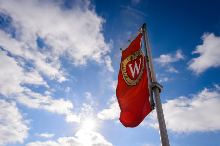 W crest banner fluttering in the wind on a sunny day
