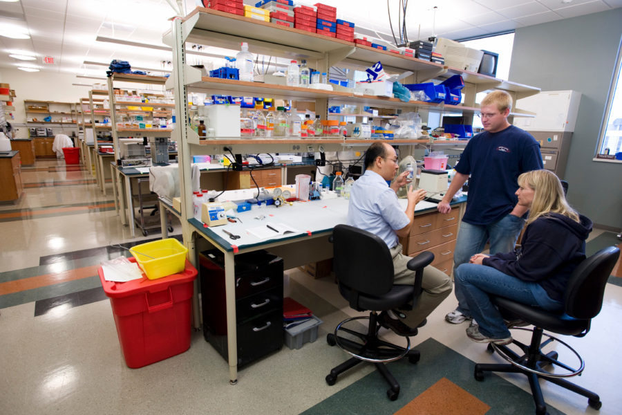 Wan-Ju Li (seated), assistant professor of orthopedics and rehabilitation in the School of Medicine and Public Health, takes with graduate students Connie Chamberlain and Andrew Handorf in their new lab space in the Wisconsin Institutes for Medical Research (WIMR) at the University of Wisconsin-Madison