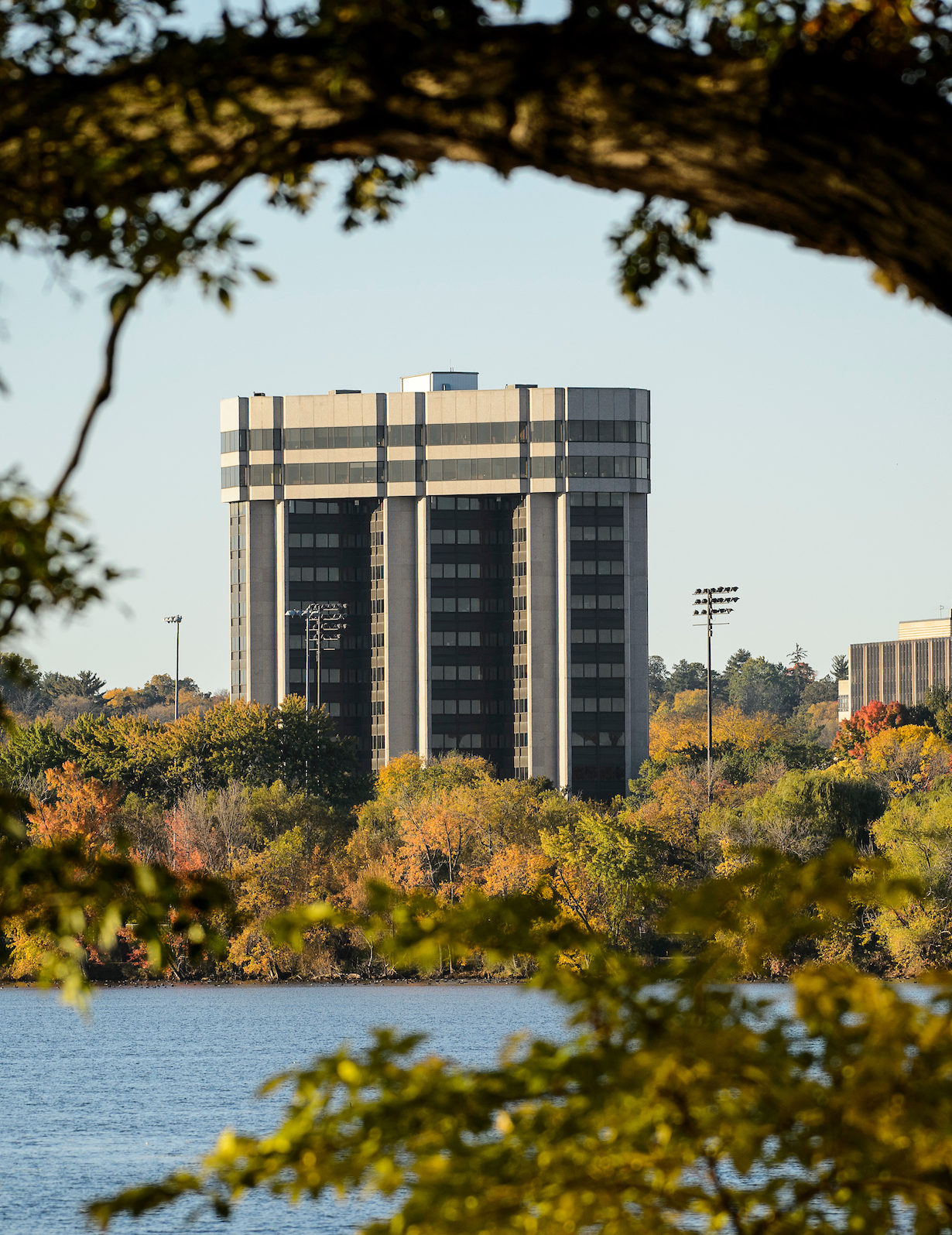 The Wisconsin Alumni Research Foundation Building (WARF) and Lake Mendota shoreline are seen from Picnic Point at the University of Wisconsin-Madison