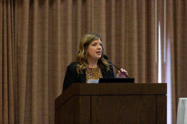 Image of a woman at a podium
