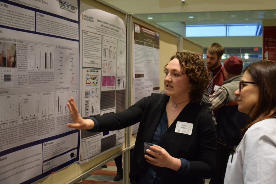 Image of researcher presenting a poster