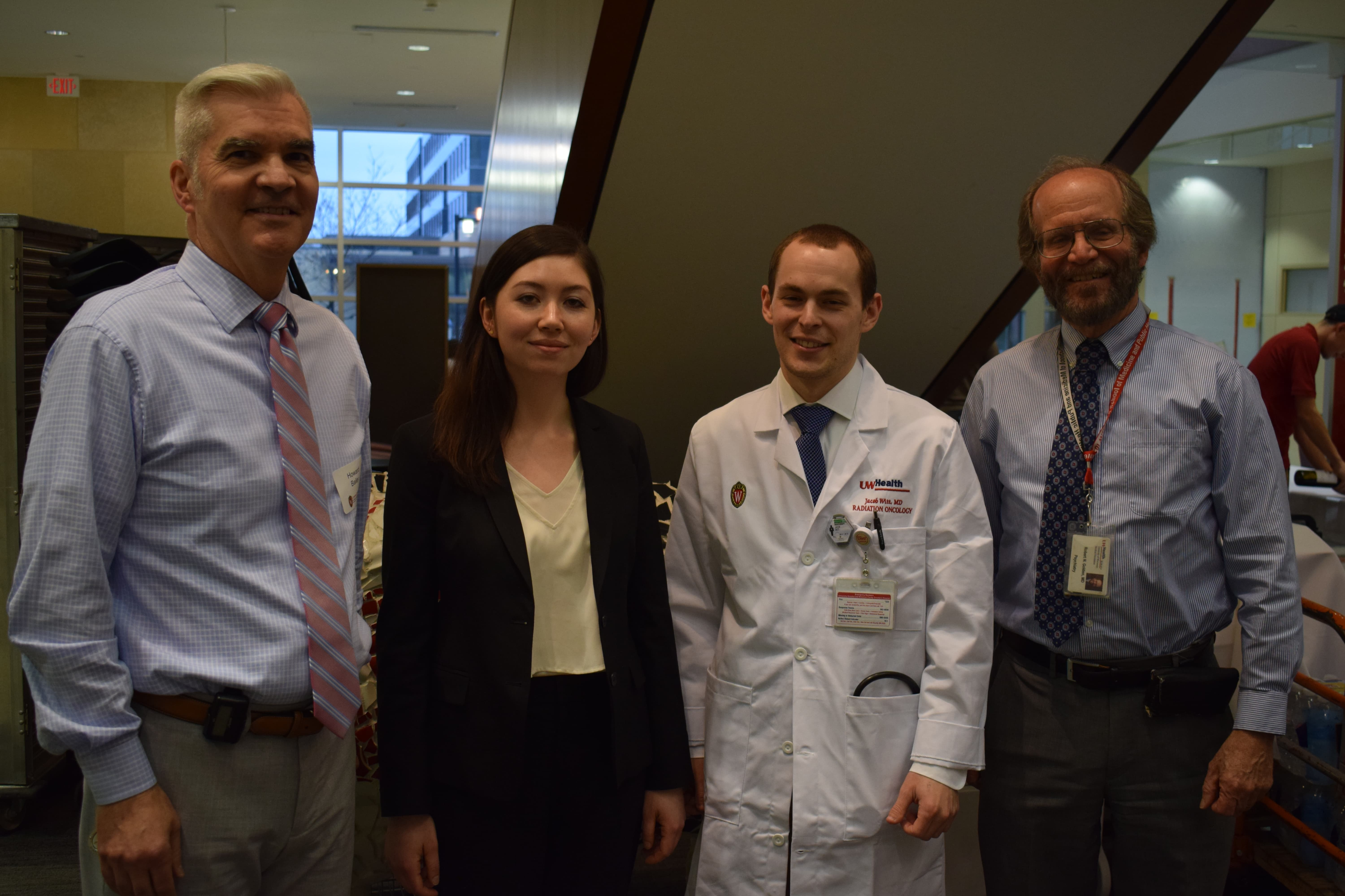 cancer biology graduate student Kristine Donahue and UW Human Oncology resident Dr. Jacob Witt pictured with Carbone Cancer Center Director Dr. Howard Bailey and SMPH Dean Dr. Robert Golden