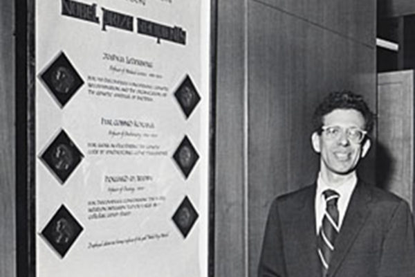 Howard Temin, professor of oncology in the McArdle Laboratory, and winner of the 1975 Nobel Prize in medicine for his work, poses next to a list of UW-Madison Nobel Prize winners at the State Capitol building.