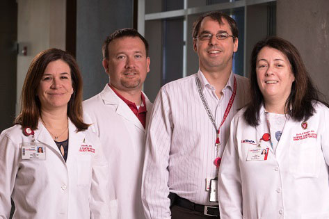 From left to right, UWCCC researchers and physicians Kari Wisinski, Dustin Deming, Mark Burkard, and Ruth O'Regan