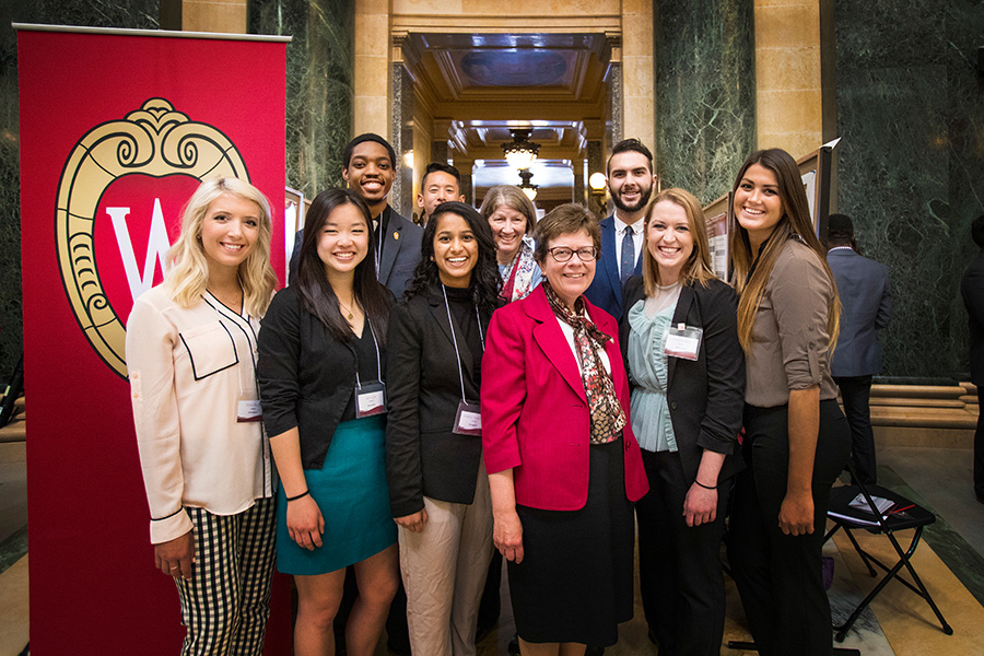 UW-Madison students and Chancellor, Rebecca Blank, pose for the picture after chancellor's visit to students who participating 14th Annual Research in the Rotunda