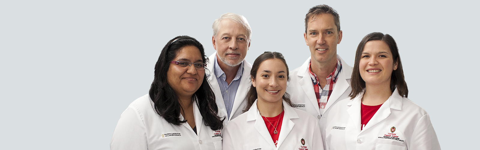 Five UW Health physicians in their lab coats posing for the camera.