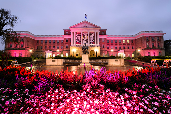 In honor of breast cancer awareness month, pink-colored accent lighting illuminates the exterior of Bascom Hall and terrace plantings surrounding the Abraham Lincoln statue at the University of Wisconsin-Madison