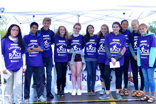 Volunteers at the annual Carbone's Race, a 5K run/walk benefiting cancer research at the UWCCC.