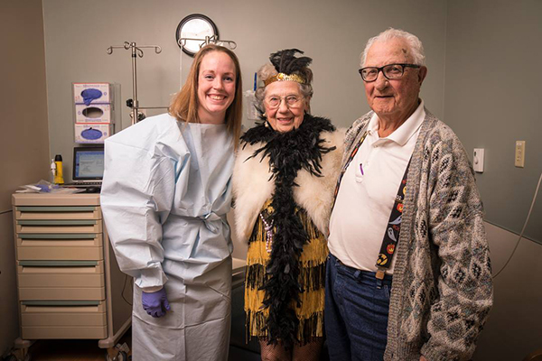 Three people dressed up on a patient's final day of treatment.